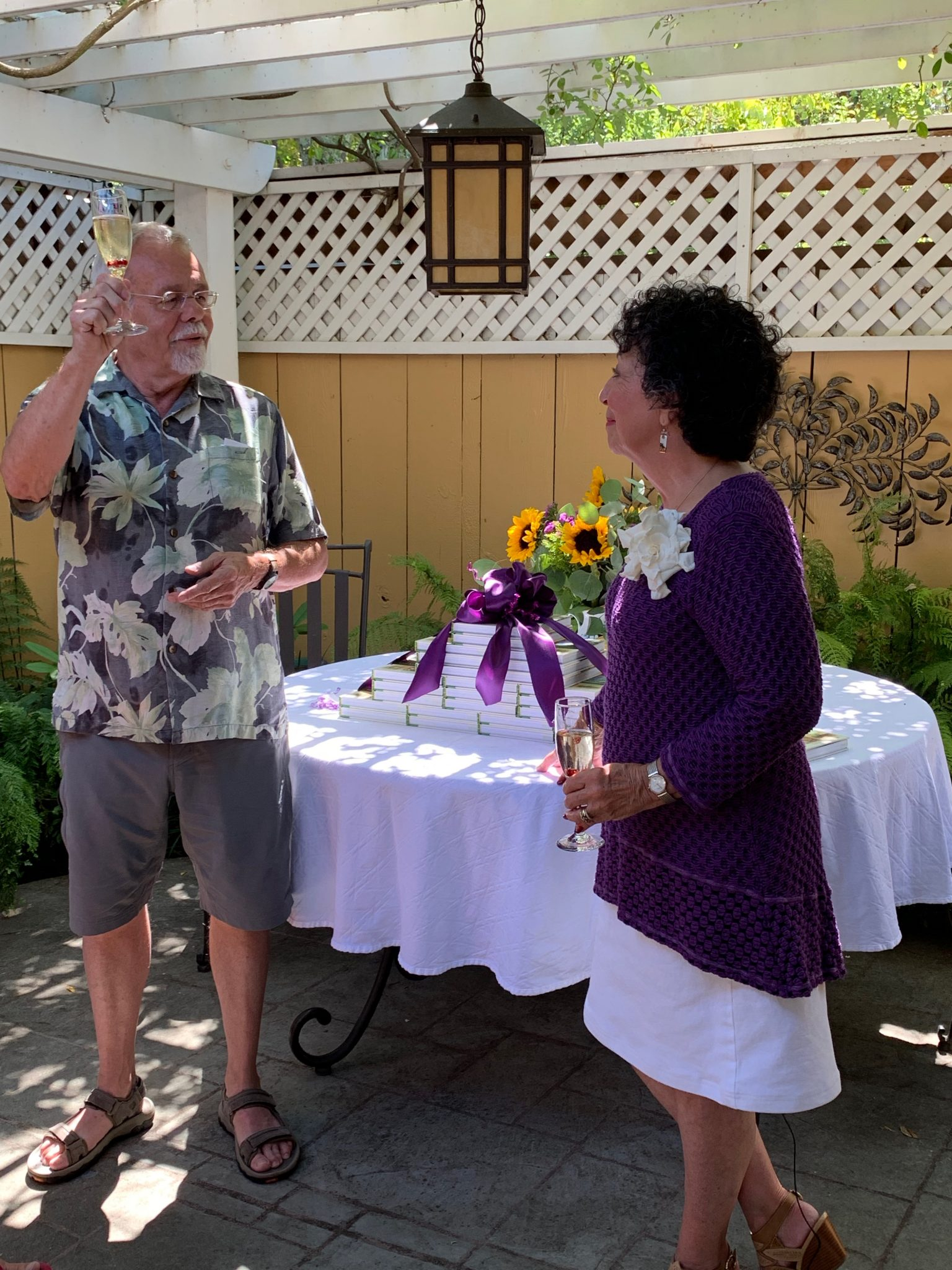 Tim King, Toni Gattone's husband, toasting his wife's success in launching her new book, The Lifelong Gardener.